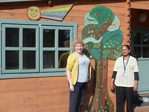 Vivien and Kalpina with Log Cabin Spring Tree