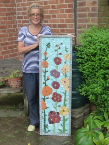 Why not make yet another, even bigger mosaic to raffle?? Souldn't take too long!